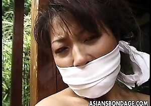 Pledged mature Asian cougar to a house beam