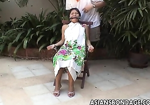 Asian teen plighted and hand cuffed in the sky a chair