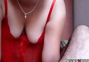 Asian MILF gives blowjob