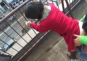 Lovely Japanese babe sucks a hard dig up outdoors