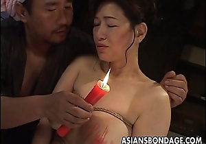 Busty Japanese chick all round hot wax BDSM action