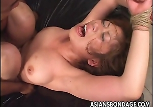 Tied up Asian babe gets fucked long together with hard
