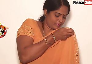 Mother debilitating a yellow saree, pellicle
