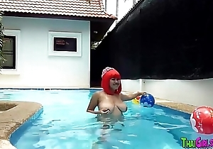 Asian redhead big tits in pool