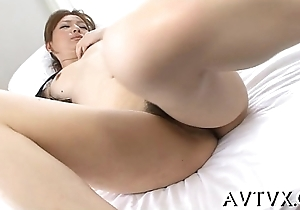 Electrifying oriental cowgirl riding