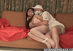 Asian slut is getting roped up and treated to a bdsm occasion
