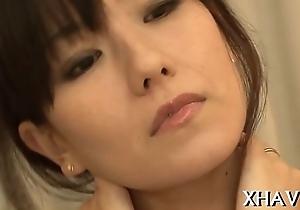 Cute oriental sits not susceptible big dildo