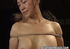 Of age bitch gets roped up and hung hither a bdsm boxing-match
